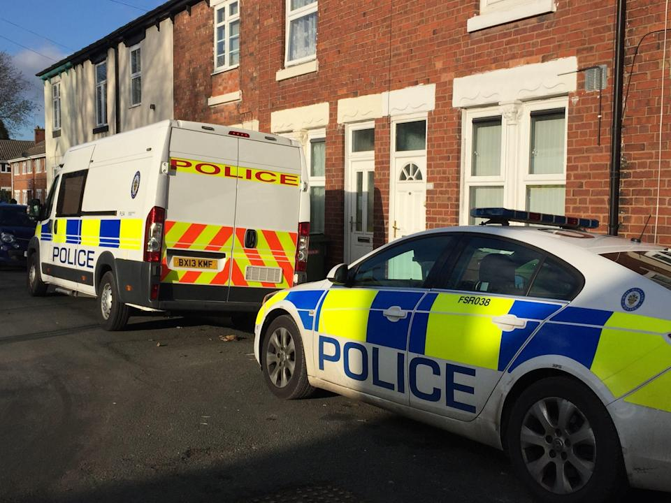 Police vehicles at the scene in James Street, Bilston, Wolverhampton, after a woman's body was found at her home. A 40-year-old man has been arrested on suspicion of murder.
