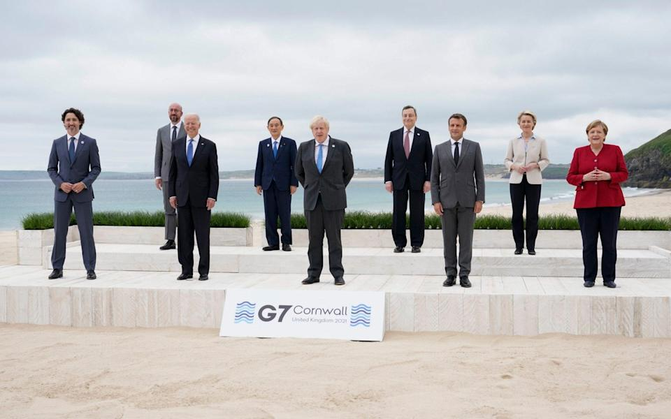G7 leaders pose for a group photo on the beach in Cornwall - AP Photo/Patrick Semansky