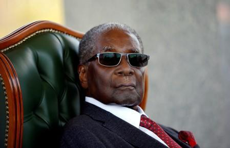"""FILE PHOTO: Zimbabwe's former president Robert Mugabe looks on during a press conference at his private residence nicknamed """"Blue Roof"""" in Harare"""