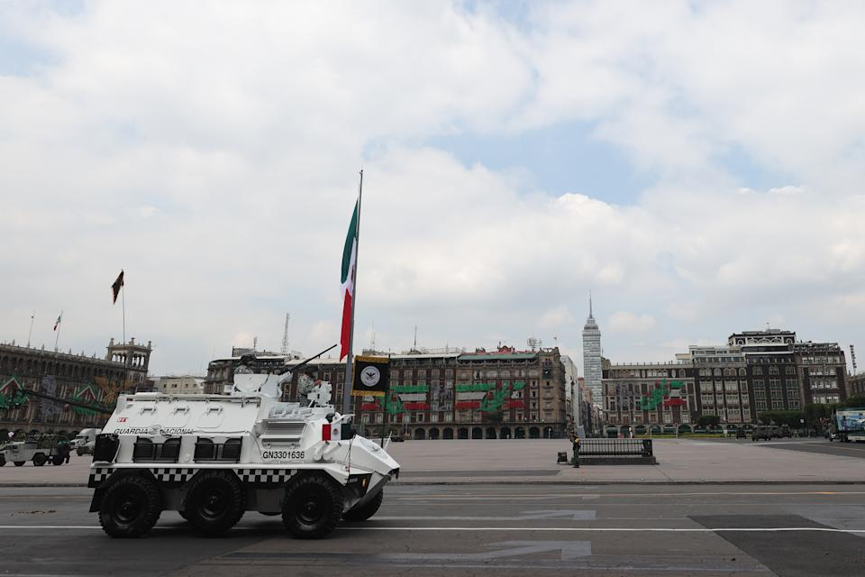 VARIOUS CITIES, MEXICO - SEPTEMBER 16: National Guards March during the Independence Day military parade at Zocalo Square on September 16, 2020 in Various Cities, Mexico. This year El Zocalo remains closed for general public due to coronavirus restrictions. Every September 16 Mexico celebrates the beginning of the revolution uprising of 1810. (Photo by Hector Vivas/Getty Images)