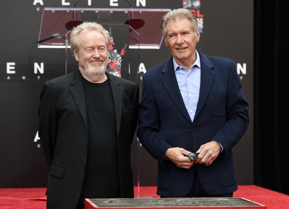 Director Sir Ridley Scott, left, and actor Harrison Ford pose together following a hand and footprint ceremony for Scott at the TCL Chinese Theatre on Wednesday, May 17, 2017 in Los Angeles. Scott directed Ford in the classic 1982 science fiction film