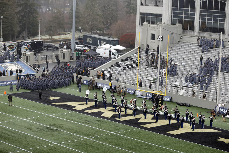 The Army band march on to the field before the 121st Army Navy NCAA college football game, Saturday, Dec. 12, 2020, in West Point, N.Y. (AP Photo/Adam Hunger)