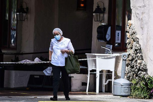PHOTO: A medical staff person walks out of Fair Havens Center nursing home facilities in Miami Springs, on May 11, 2020. (Chandan Khanna/AFP via Getty Images)