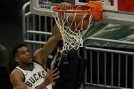 Milwaukee Bucks' Giannis Antetokounmpo dunks during the first half of an NBA basketball game against the Minnesota TimberwolvesTuesday, Feb. 23, 2021, in Milwaukee. (AP Photo/Morry Gash)