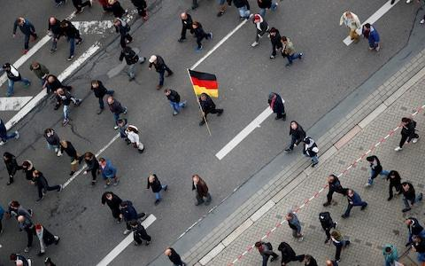 People gather during demonstrations following the killing of a German man in Chemnitz - Credit: REUTERS/Hannibal Hanschke