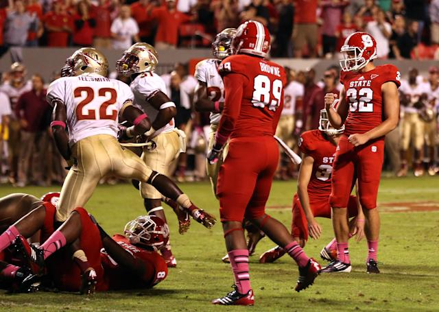 RALEIGH, NC - OCTOBER 06: Niklas Sade #32 of the North Carolina State Wolfpack celebrates with teammates after kicking an extra point that won the game 17-16 against the Florida State Seminoles during their game at Carter-Finley Stadium on October 6, 2012 in Raleigh, North Carolina. (Photo by Streeter Lecka/Getty Images)