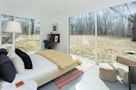 "<p>This Airbnb in Michigan City is a great spot to enjoy the sandy Indiana Dunes National Park on the shores of Lake Michigan. The modern, sun-filled home will make it hard to leave, though, with its floor-to-ceiling windows—all three bedrooms having sliding doors looking out at the surrounding trees—and reading nook complete with its own fireplace. The large, open-plan kitchen and living area will get plenty of use too, with family and friends gathering around the massive kitchen island or cozying up onto the couch. </p> <p><strong>Book now:</strong> <a href=""https://airbnb.pvxt.net/56vRj"" rel=""nofollow noopener"" target=""_blank"" data-ylk=""slk:From $375 per night, airbnb.com"" class=""link rapid-noclick-resp"">From $375 per night, airbnb.com</a></p>"