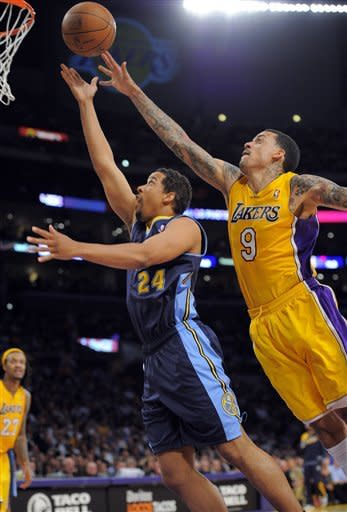 Denver Nuggets point guard Andre Miller, left, puts up shot as Los Angeles Lakers small forward Matt Barnes defends during the second half in Game 5 of an NBA first-round playoff basketball game, Tuesday, May 8, 2012, in Los Angeles. The Nuggets won 102-99. (AP Photo/Mark J. Terrill)