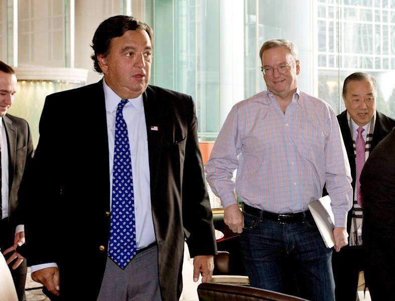 Google's executive chairman Eric Schmidt, second from right, and former New Mexico Gov. Bill Richardson, left, leave after their meeting at a hotel in Beijing Monday, Jan. 7, 2013. Schmidt, who is part of a delegation led by Richardson, is scheduled to leave Monday on a commercial flight bound for North Korea, a country considered to have the world's most restrictive Internet policies. (AP Photo/Andy Wong)