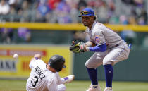 New York Mets shortstop Francisco Lindor, right, loses the ball after forcing out Colorado Rockies' Dom Nunez at second base as he tried to advance from first base on a sacrifice bunt by Antonio Senzatela in the third inning of a baseball game Sunday, April 18, 2021, in Denver. (AP Photo/David Zalubowski)