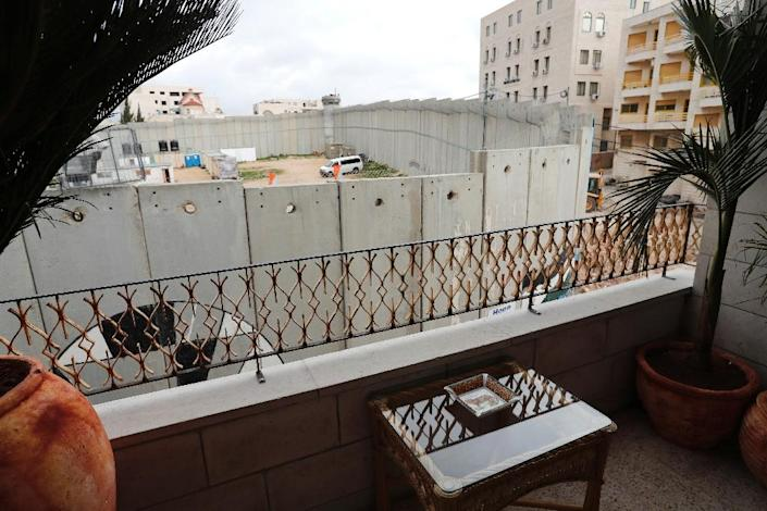 Banky's Walled-Off Hotel is only four metres (yards) from the controversial Israeli wall which cuts through the occupied West Bank and all the rooms face it (AFP Photo/Thomas COEX)