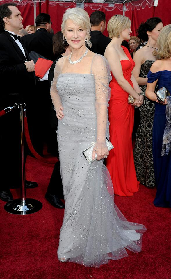 Helen Mirren   Grade: B    The Best Actress nominee delivered another command performance in her sparkling silver satin crepe and tulle Badgley Mischka creation. If only we could all look this good at 64!