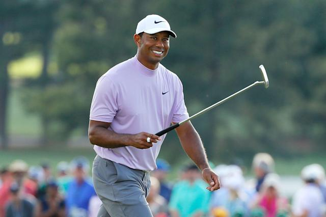 Tiger Woods of the United States smiles as he walks on the 18th hole during the third round of the Masters at Augusta National Golf Club on April 13, 2019 in Augusta, Georgia. (Getty Images)