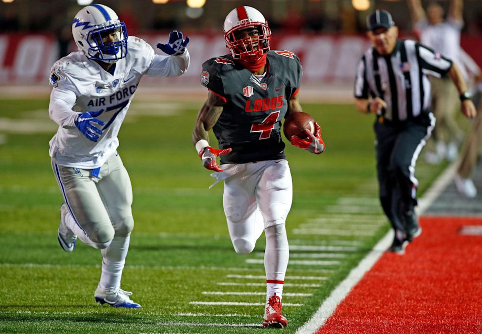 New Mexico running back Romell Jordan (4) sprints to the end zone past Air Force linebacker Ja'Mel Sanders (7) during the second half of an NCAA college football game in Albuquerque, N.M., Saturday, Sep. 30, 2017. (AP Photo/Andres Leighton)