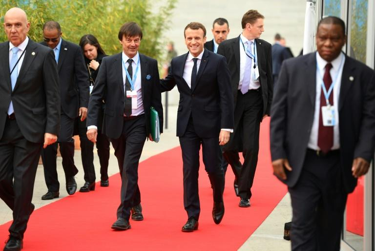French President Emmanuel Macron (C-R) and French Minister for the Ecological and Inclusive Transition Nicolas Hulot (C-L) arrive to attend the UN conference on climate change (COP23) on November 15, 2017 in Bonn, western Germany