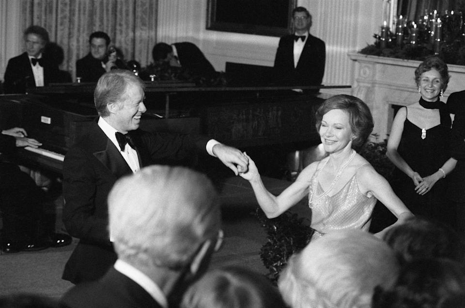 <p>The President was in the holiday spirit, as he twirled his wife First Lady Rosalynn Carter on the dance floor at the White House Christmas Ball in 1978. He wore a classic tuxedo and a big butterfly bowtie for the evening. <br></p>