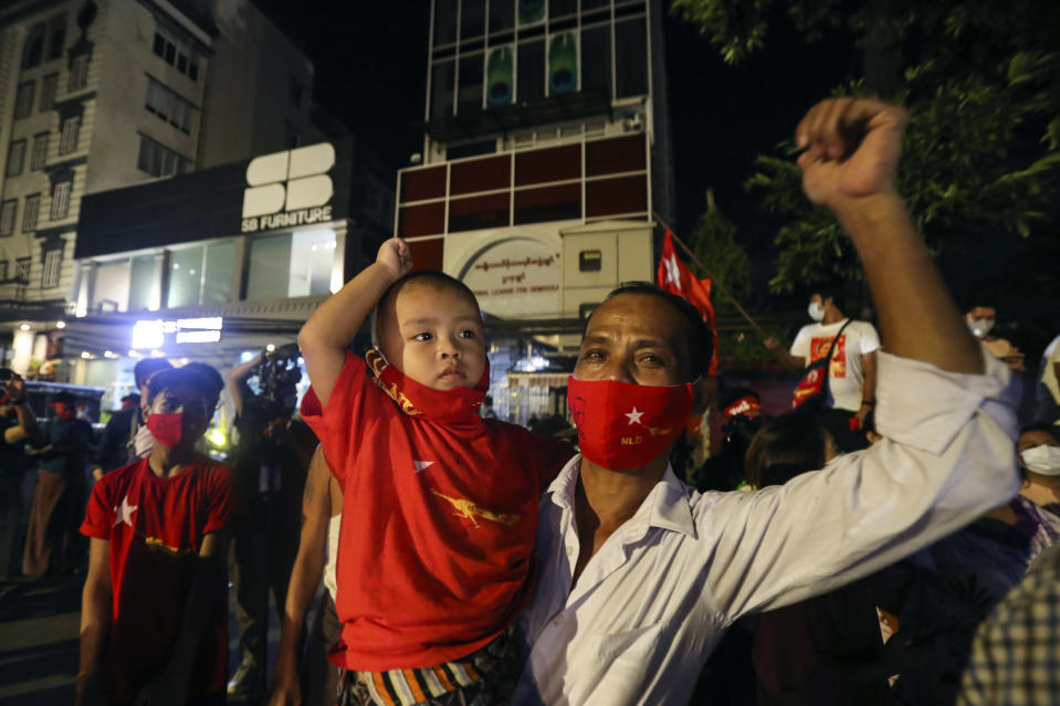 Supporters wearing face mask cheer as they gather in front of Myanmar Leader Aung San Suu Kyi's National League for Democracy (NLD) party's headquarters during Election Day Sunday, Nov. 8, 2020, in Yangon, Myanmar. (AP Photo/Thein Zaw)