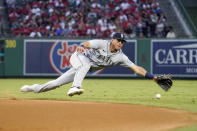 Seattle Mariners second baseman Dylan Moore can't reach a ball hit for a single by Los Angeles Angels' Juan Lagares during the fifth inning of a baseball game Friday, July 16, 2021, in Anaheim, Calif. (AP Photo/Mark J. Terrill)