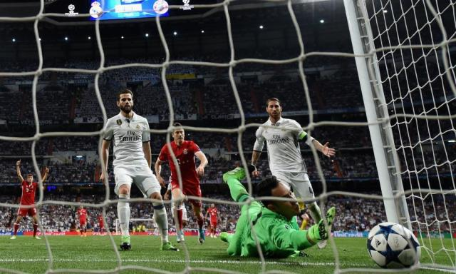 "<span class=""element-image__caption"">Sergio Ramos, right, can only watch as his touch dribbles past Keylor Navas.</span> <span class=""element-image__credit"">Photograph: Matthias Hangst/Bongarts/Getty Images</span>"
