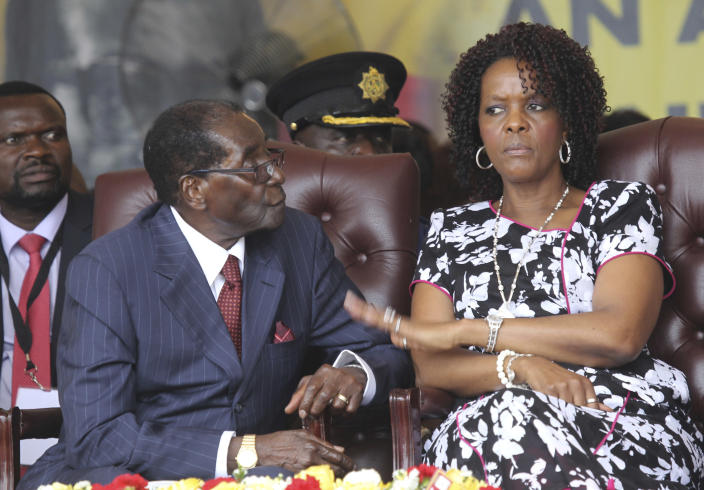 """FILE - In this Saturday, Feb. 27, 2016 file photo, Zimbabwean President Robert Mugabe, left, sits with his wife Grace during commemorations to mark his 92nd Birthday celebrations. Mugabe has described his wife, an increasingly political figure, as """"fireworks"""" in an interview marking his 93rd birthday on Tuesday, Feb. 21, 2017. (AP Photo/Tsvangirayi Mukwazhi, File)"""