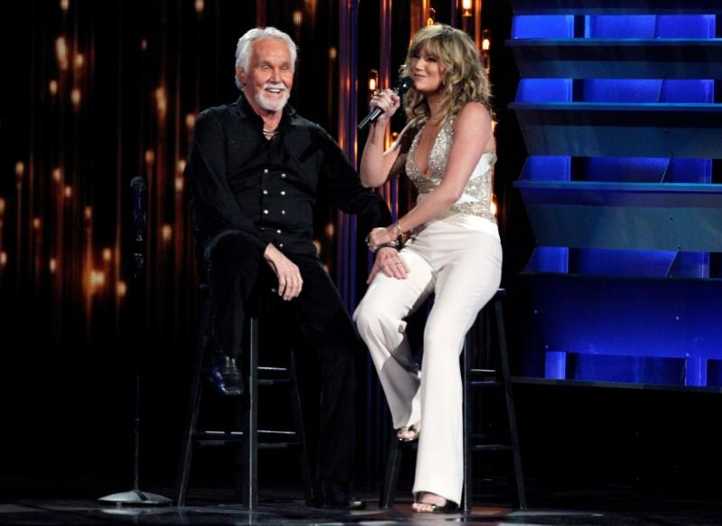 FILE PHOTO: Jennifer Nettles sings a tribute to Kenny Rogers before he receives the Willie Nelson Lifetime Achievement award at the 47th Country Music Association Awards in Nashville