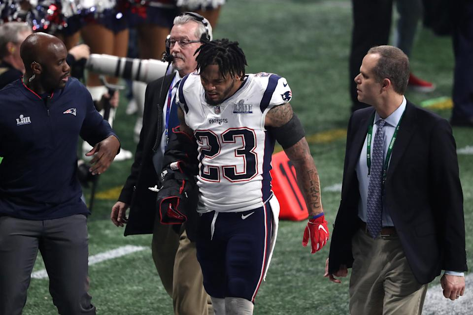 Patrick Chung walked off the field after suffering an arm injury in the third quarter. (Getty)