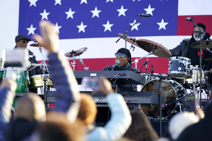 Stevie Wonder performs before Democratic presidential candidate former Vice President Joe Biden and former President Barack Obama speak at a rally at Belle Isle Casino in Detroit, Mich., Saturday, Oct. 31, 2020. (AP Photo/Andrew Harnik)