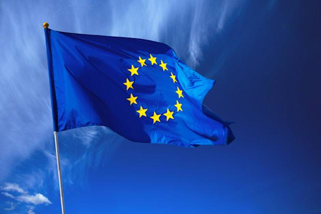 Flag of the european union in front of the deep blue sky.