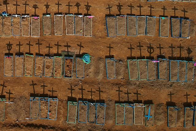 An aerial view of crosses casting shadows at the Parque Taruma cemetery, amid the coronavirus disease (COVID-19) outbreak, in Manaus, Brazil, June 15, 2020. Picture taken with a drone. REUTERS/Bruno Kelly