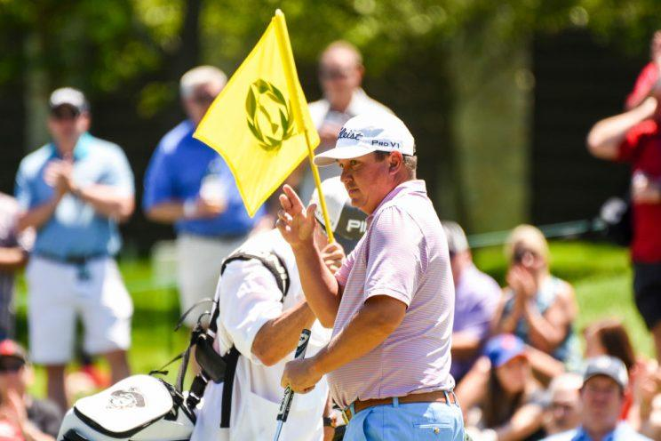 Dufner rekindles magic to win weather-hit Memorial