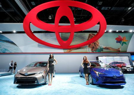 FILE PHOTO: A Toyota Prius and a Prius V are displayed at the North American International Auto Show in Detroit