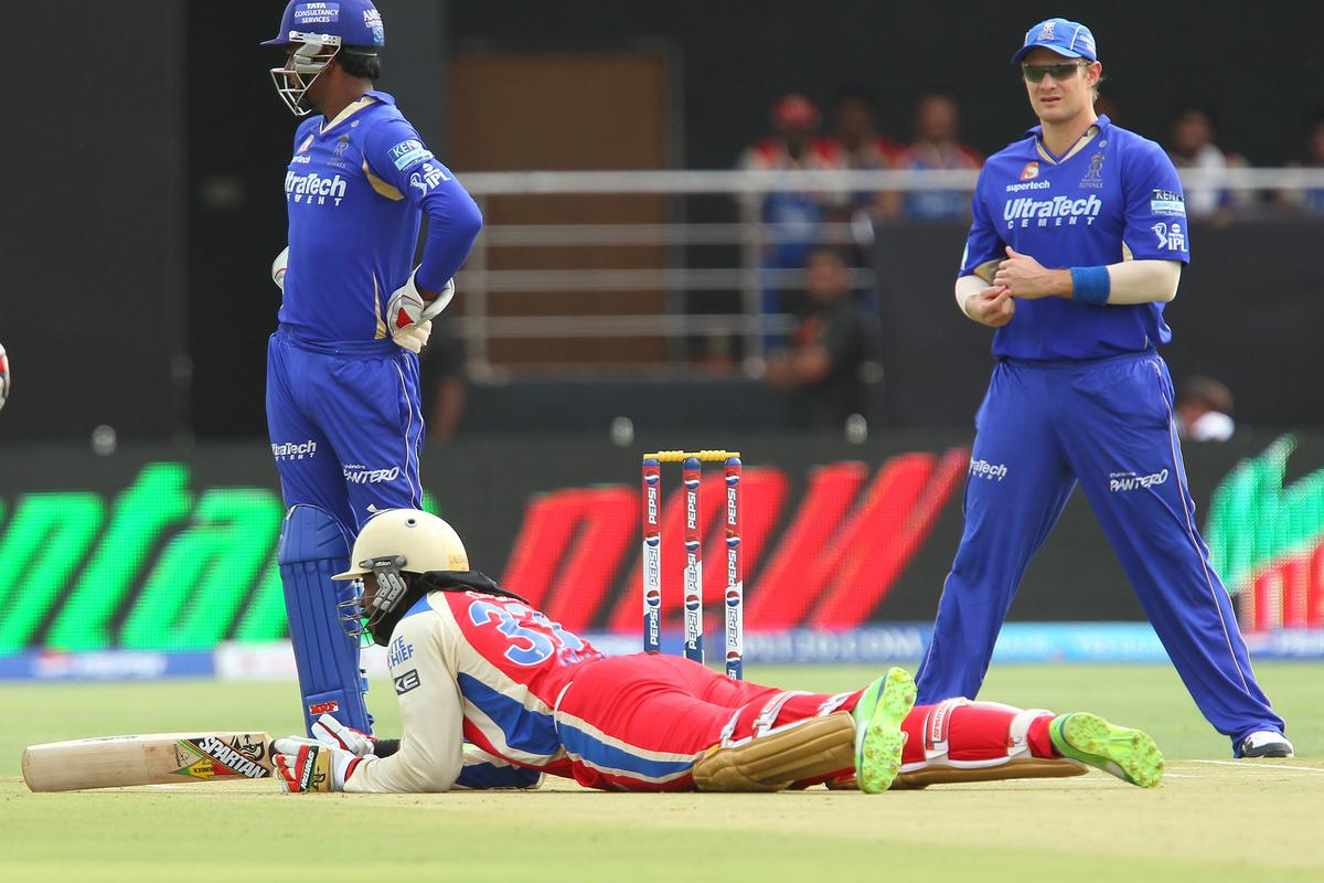 Chris Gayle slips whilst batting during match 40 of the Pepsi Indian Premier League ( IPL) 2013  between The Rajasthan Royals and the Royal Challengers Bangalore held at the Sawai Mansingh Stadium in Jaipur on the 29th April 2013..Photo by Ron Gaunt-IPL-SPORTZPICS ..Use of this image is subject to the terms and conditions as outlined by the BCCI. These terms can be found by following this link:..https://ec.yimg.com/ec?url=http%3a%2f%2fwww.sportzpics.co.za%2fimage%2fI0000SoRagM2cIEc&t=1500669072&sig=KjL.YmZcUseoT4c_YAH3jA--~C