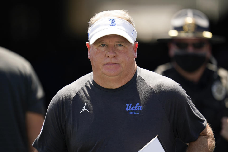 UCLA head coach Chip Kelly walks on to the field before an NCAA college football game against Hawaii Saturday, Aug. 28, 2021, in Pasadena, Calif. (AP Photo/Ashley Landis)