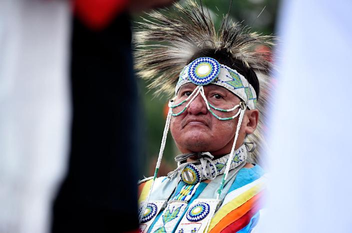 <p>Standing Rock Sioux tribe member Robert Ironshield Jr. listens to a speaker during a rally protesting the proposed Dakota Access oil pipeline on Sept. 13, 2016, in Boulder, Colo. (Photo: Jeremy Papasso/Daily Camera via AP) </p>