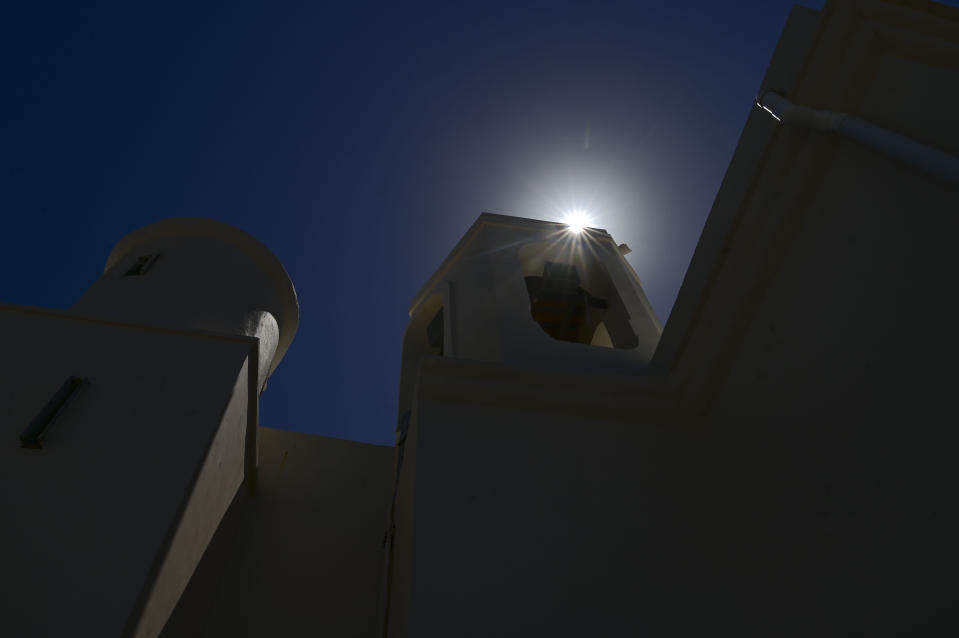 The midday sun rises over the facade of the second oldest Spanish church in the Americas, the San Jose Church, that will reopen following a massive reconstruction that took nearly two decades to complete, in San Juan, Puerto Rico, Tuesday, March 9, 2021. The church was built for a Dominican convent, served as a shelter during an attack by the Indigenous Taínos, became Puerto Rico's first high school and was damaged by a cannonball during the 1898 Spanish-American War in which Spain ceded Puerto Rico to the U.S. (AP Photo/Carlos Giusti)