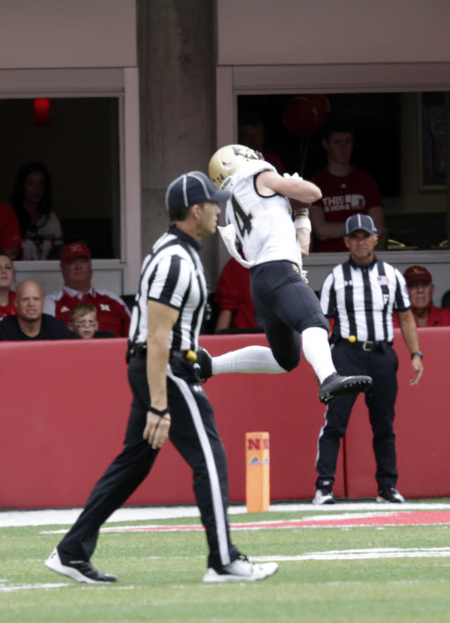 Colorado wide receiver Jay MacIntyre (14) makes a touchdown catch during the first half of an NCAA college football game against Nebraska in Lincoln, Neb., Saturday, Sept. 8, 2018. (AP Photo/Nati Harnik)