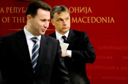 FILE PHOTO: Macedonian Prime Minister Nikola Gruevski (L) stands in front of his Hungarian counterpart Viktor Orban during news conference in Skopje May 12, 2011.    REUTERS/Ognen Teofilovski/File Photo