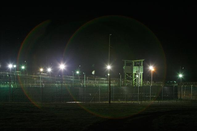 GUANTANAMO BAY, CUBA - OCTOBER 03: (IMAGE REVIEWED BY U.S. MILITARY PRIOR TO TRANSMISSION) Bright lights, guard towers and razor wire-topped fences mark the perimeter of the Camp Delta detention facility October 3, 2007 at the U.S. Naval Station at Guantanamo Bay, Cuba. About 340 enemy combatants captured since the September 11, 2001 attacks on the U.S. continue to be held on the island. (Photo by Chip Somodevilla/Getty Images)