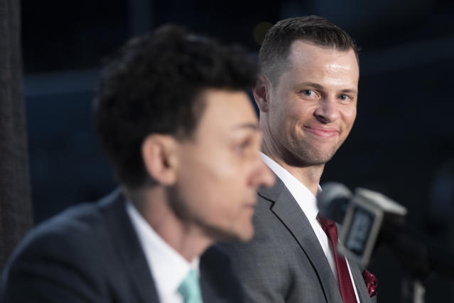 New York Liberty WNBA basketball team new head coach Walt Hopkins, right, smiles as General manager Jonathan Kolb introduces him to reporters during a news conference at Barclays Center, Wednesday, Jan. 8, 2020, in New York. (AP Photo/Mary Altaffer)