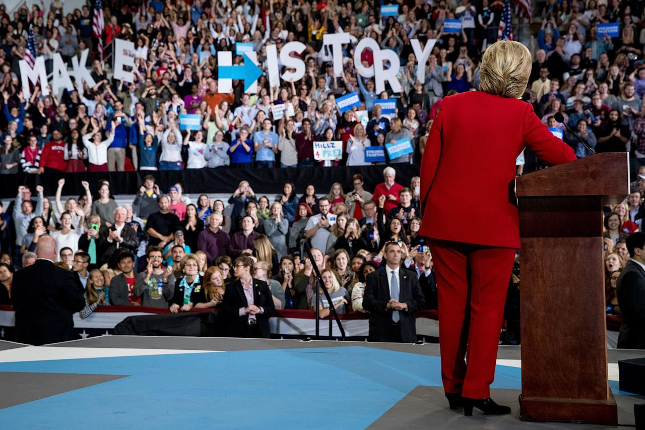 <p>Democratic presidential candidate Hillary Clinton pauses while speaking at a midnight rally at Reynolds Coliseum at North Carolina State University in Raleigh, N.C., Tuesday, Nov. 8, 2016. (Photo: Andrew Harnik/AP) </p>