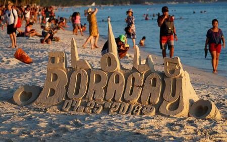 A sand sculpture is seen along the beach, a day before the temporary closure of the holiday island Boracay, in the Philippines