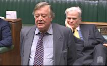 Sir Desmond Swayne MP sitting behind former Chancellor Ken Clarke as he speaks during a House of Commons debate on Brexit.