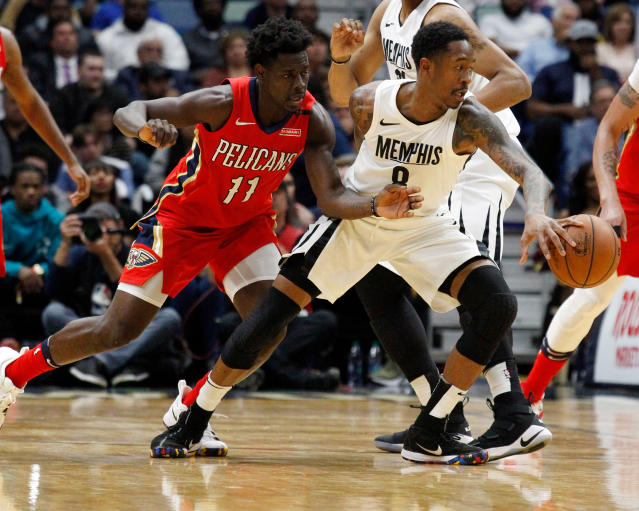 "<a class=""link rapid-noclick-resp"" href=""/nba/teams/mem"" data-ylk=""slk:Memphis Grizzlies"">Memphis Grizzlies</a> guard MarShon Brooks (8) keeps the ball from <a class=""link rapid-noclick-resp"" href=""/nba/teams/nor"" data-ylk=""slk:New Orleans Pelicans"">New Orleans Pelicans</a> guard <a class=""link rapid-noclick-resp"" href=""/nba/players/4622/"" data-ylk=""slk:Jrue Holiday"">Jrue Holiday</a> (11) during the second half of an NBA basketball game in New Orleans, Wednesday, April 4, 2018. The Pelicans won 123-95. (AP Photo/Scott Threlkeld)"