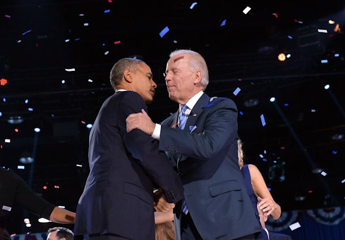 US President Barack Obama (L) shakes hands with Vice President Joe Biden on stage after delivering his victory speech in Chicago on November 7, 2012. Obama swept to re-election, forging history again by transcending a slow economic recovery and the high unemployment which haunted his first term to beat Republican Mitt Romney. AFP PHOTO/Jewel SAMAD        (Photo credit should read JEWEL SAMAD/AFP/Getty Images)
