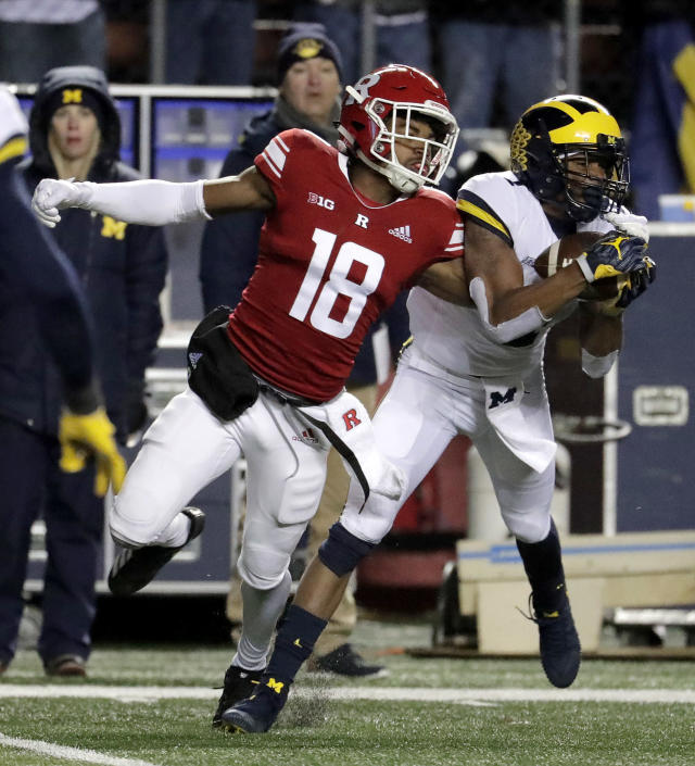 FILE - In this Saturday, Nov. 10, 2018, file photo, Michigan defensive back Ambry Thomas, right, intercepts a pass from Rutgers quarterback Artur Sitkowski which was intended for wide receiver Bo Melton, left, during the second half of an NCAA college football game, in Piscataway, N.J. Thomas' career highlight is returning a kickoff 99 yards for a touchdown against Notre Dame. Now, in 2019, he gets his opportunity at corner, where he was a four-star recruit and one of the nations top prospects in 2016. (AP Photo/Julio Cortez, File)