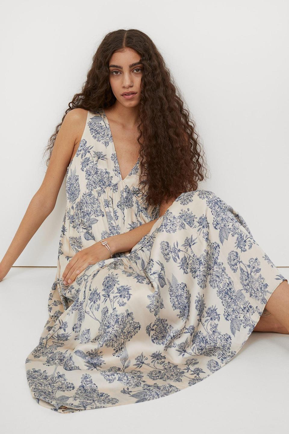 <p>This eye-catching <span>Long V-neck Dress</span> ($50) will pique everyone's curiosity when you wear it to the next brunch. The floral motifs give it a romantic and modern feel.</p>