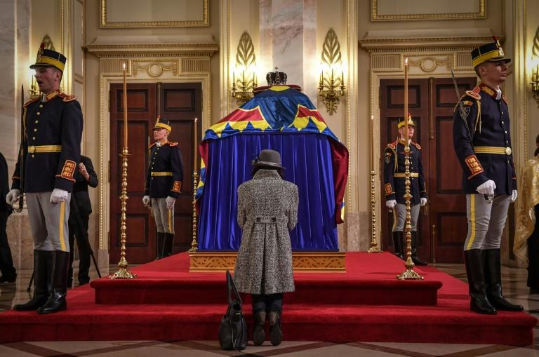 A woman says goodbye in front of former Romanian king Michael's coffin at the Royal Palace in Bucharest