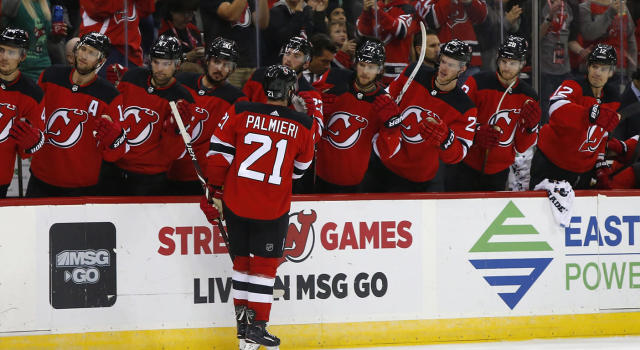 "The <a class=""link rapid-noclick-resp"" href=""/nhl/teams/njd"" data-ylk=""slk:New Jersey Devils"">New Jersey Devils</a> have been flying early. (Noah K. Murray/AP)"