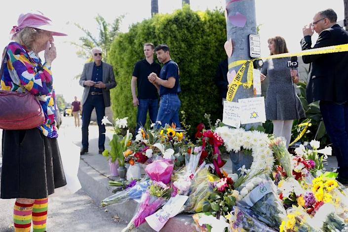 The era of increasingly high-profile hate crimes such as the deadly Chabad of Poway Synagogue shooting in April 2019 may have finally caught up with Farrakhan (AFP Photo/SANDY HUFFAKER)