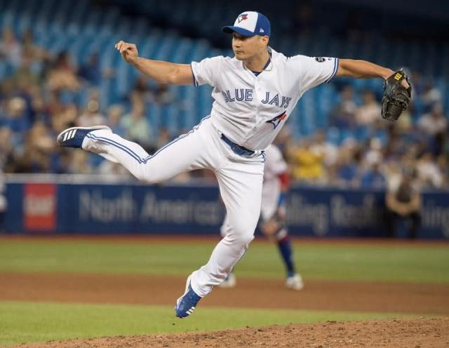 Toronto Blue Jays reliever Seunghwan Oh was traded to Colorado Rockies on Thursday. (CP)